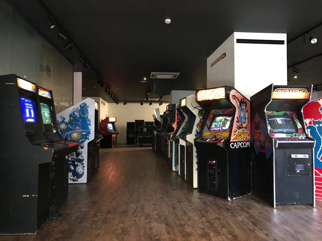 Low level shot of rows of arcade machines